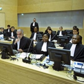 Luis Moreno-Ocampo (front C) and other members of the Office of the Prosecutor attend the hearing of of Francis Muthaura, Uhuru Kenyatta and Mohammed Hussein Ali at the International Criminal Court (ICC) in The Hague, September 21, 2011