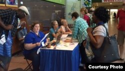 Delegates making last minute registration in Harrisburg, Pennyslvania, USA. (Photo: Mennonite Conference 2015)