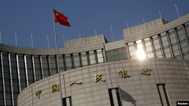 A Chinese national flag flies at the headquarters of the People's Bank of China, the country's central bank, in Beijing, Jan. 19, 2016.