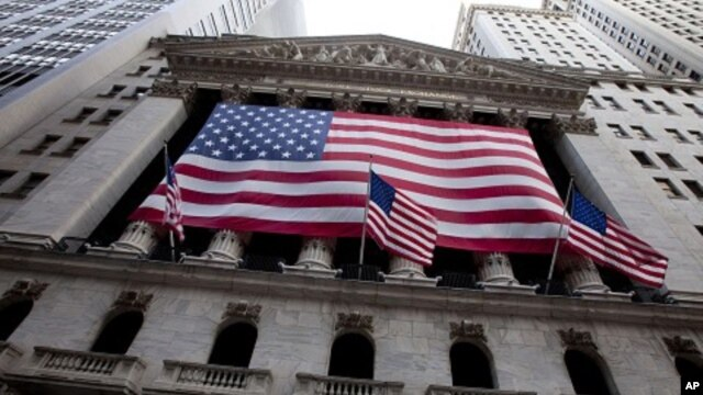 US flag flies from the New York Stock Exchange in New York, August 5, 2011