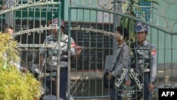 Armed Police at the entrance of a school at Sittwe City, Myanmar