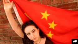 FILE - American Melissa Sconyers, who studied abroad in China, poses with Chinese flag in San Francisco.