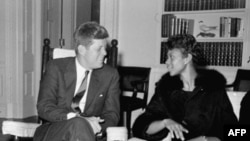 President John Kennedy chats in his White House office with Wilma Rudolph in 1961, the year after she won three gold medals at the Olympic Games in Rome