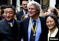 FILE - Actor and activist Richard Gere is flanked by and Lodi Gyari, left, special envoy of the Dalai Lama and Tsering Jampa, right, Chairman of the ICT after the Geuzen Penning ceremony in Vlaardingen, The Netherlands, March 12, 2005.