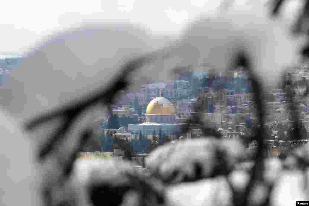Jerusalem's Old City and the Dome of the Rock in the compound, known to Muslims as Noble Sanctuary and to Jews as Temple Mount, are seen following a snowstorm of rare intensity that blanketed the Jerusalem area and parts of the occupied West Bank.