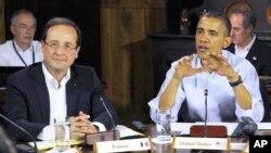 امریکہ کہ صدر براک اوباما اور اُن کے فرانسیسی ہم منصب فرانسواں اولاندے (فائل فوٹو)
