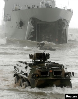 FILE PHOTO - Chinese amphibious armoured vehicles take part in the China-Russia joint military exercise in eastern China's Shandong peninsula, China August 24, 2005.