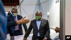 South African President Cyril Ramaphosa visits COVID-19 treatment facilities at the NASREC Expo Centre in Johannesburg, South Africa, April 24, 2020.