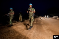 FILE - Peacekeeper troops from Ethiopia in the U.N. Interim Security Force for Abyei (UNISFA) patrol at night in Abyei town, Abyei state, Dec. 14, 2016.