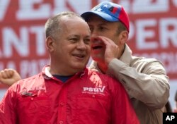 Government politician Diosdado Cabello, left, listens to Venezuela's Vice President Tareck El Aissami during a rally against the United States in Caracas, Venezuela, March 28, 2017.