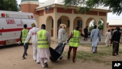 Rescue workers remove a body after a suicide attack at a camp of people displaced by Islamist extremist in Maiduguri, Nigeria, July 24, 2017. Female suicide bombers attacked two displaced persons camps in northeastern Nigeria's main city.