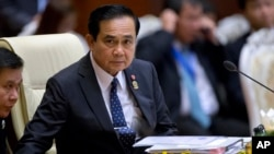 FILE - Thailand's Prime Minister Prayuth Chan-ocha attends the Association of Southeast Asian Nations (ASEAN) plenary session at Myanmar International Convention Center in Naypyitaw, Myanmar, Nov. 12, 2014.