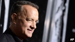 FILE - Actor Tom Hanks arrives at a film screening in Beverly Hills, California, Sept. 30, 2013.
