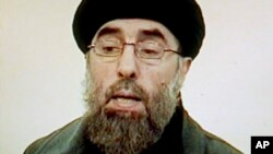 "FILE - Afghan rebel leader Gulbuddin Hekmatyar is seen in this photo grab from a video received by Associated Press Television in Karachi, Pakistan. Seeking to gain new leverage, the notorious Afghan warlord who was designated a ""global terrorist"" by the"