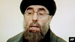 """FILE - Afghan rebel leader Gulbuddin Hekmatyar is seen in this photo grab from a video received by Associated Press Television in Karachi, Pakistan. Seeking to gain new leverage, the notorious Afghan warlord who was designated a """"global terrorist"""" by the"""