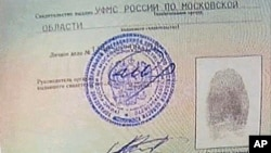 An image taken from AP Television shows a copy of a temporary document that allows Edward Snowden to cross the border into Russia, held by Russian lawyer Anatoly Kucherena visiting Snowden at Sheremetyevo airport outside Moscow, August 1, 2013.