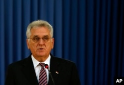 Serbian President Tomislav Nikolic addresses the press after talks with his Macedonian counterpart Gjorge Ivanov, in Belgrade, Serbia, Oct. 28, 2016.