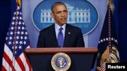 바락 오바마 미국 대통령이 19일 워싱턴 백악관에서 이라크 사태에 관한 입장을 밝히고 있다.
