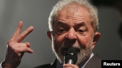 FILE PHOTO - Former Brazilian President Luiz Inacio Lula da Silva speaks after giving testimony to federal judge Sergio Moro in Curitiba, Brazil, May 10, 2017.