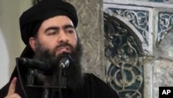 FILE - Image taken a from video shows a man purported to be Abu Bakr al-Baghdadi, senior leader of the Islamic State militant group.