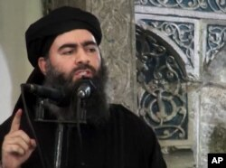 FILE - Image taken a from video shows a man purported to be Abu Bakr al-Baghdadi, senior leader of the so-called Islamic State militant group.