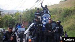 Members of the Honduran police arrive at their headquarters to take part in a strike to demand higher wages and rest after working extra hours due to protests caused by the delay in vote counting in the general election, in Tegucigalpa, Honduras, Dec. 4,