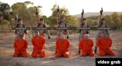 A screenshot from an undated Islamic State propaganda video purports to show young boys executing captured enemy fighters.