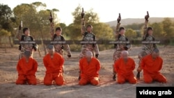 FILE - A screenshot from an Islamic State propaganda video purports to show young boys preparing to execute a group of captives.