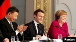 中国国家主席习近平、法国总统马克龙、德国总理默克尔在法国巴黎爱丽舍总统府举行新闻发布会(2019年3月26日)