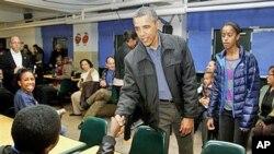 奥巴马总统1月16日在华盛顿参加一个社区服务活动,纪念民权领袖马丁·路德·金