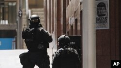 FILE - Police anti-terror forces are seen dispatched in Martin Place in the central business district of Sydney, Australia, Dec. 15, 2014.