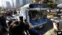 A bus carrying Cho Hyun-ah, former vice president of Korean Air Lines Co., arrives for her trial at the Seoul Western District Court in Seoul, South Korea, Monday, Feb. 2, 2015.