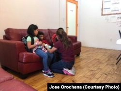 Yeni Gonzalez is reunited with her three children at the Cayuga Care Center in New York, July 3, 2018.