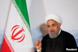 FILE - Iranian President Hassan Rouhani addresses the Innovation and Industry Forum during an official visit in Bern, Switzerland, July 3, 2018.