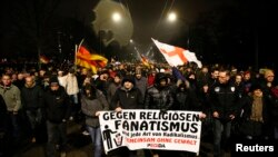 "Participants take part in a demonstration called by anti-immigration group PEGIDA, a German abbreviation for ""Patriotic Europeans against the Islamization of the West"", in Dresden, Jan. 5, 2015."