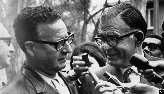 FILE - Salvador Allende (L) of the Marxist left-wing coalition is congratulated on his victory in the Chilean presidential election by Christian Democrat candidate Radomiro Tomic at Allende's home, Sept. 5, 1970 in Santiago, Chile.