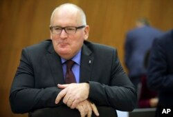 European Commission Vice-President Frans Timmermans waits for the start of a meeting of the College of Commissioners at EU headquarters in Brussels, Dec. 6, 2017.
