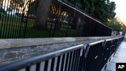 FILE - Two layers of fence are seen along the North Lawn of the White House in Washington, D.C., Sept. 23, 2014.