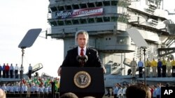 FILE - President Bush declares the end of major combat in Iraq as he speaks aboard the aircraft carrier USS Abraham Lincoln off the California coast, May 1, 2003.