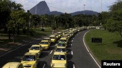 Taxis parked on the street are pictured during a protest against the online car-sharing service Uber in Rio de Janeiro, July 24, 2015.