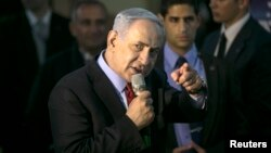 Israel's Prime Minister Benjamin Netanyahu gestures as he speaks to supporters of his Likud party as he campaigns in Netanya, north of Tel Aviv, March 11, 2015.