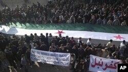 ဆီးရီးယားသမၼတ ဘက္ရွာအယ္လ္အာဆဒ္ ျပဳတ္က်ေရး Idlib ၿမိဳ႕အနီး ေတာင္းဆိုဆႏၵျပေနၾကတဲ့ ဆီးရီးယားျပည္သူမ်ား။ (ဒီဇင္ဘာလ ၃၁၊ ၂၀၁၁)