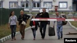 Українські біженці на кордоні з Росією