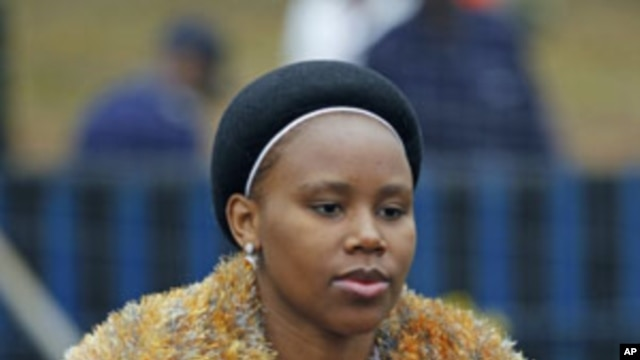 One of Swazi King Mswati's 13 wives arrives for the annual Reed Dance, at Ludzidzini in Swaziland, August 28, 2011.