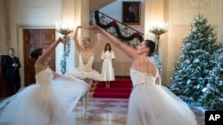 First lady Melania Trump watches dancers perform as part of the opening of the White House holiday season.
