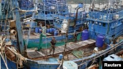 Police officers stand on a fishing boat during a police inspection at the pier of Songkhla, south Thailand, Dec. 23, 2015. Thailand said seafood exports to the United States, Europe and Australia have not been hit by reports of slavery and forced labor by campaign groups and media. Australia is proposing laws to make it a leader in fighting slavery.