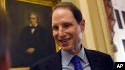 FILE - Sen. Ron Wyden, D-Ore. talks with a reporter before the start of a meeting with Senate Democrats on Capitol Hill in Washington, May 22, 2015.
