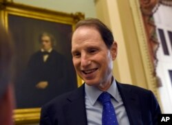FILE - Sen. Ron Wyden, D-Ore. talks with a reporter on Capitol Hill in Washington, May 22, 2015.