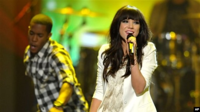 FILE - This Nov. 18, 2012 file photo shows Carly Rae Jepsen performing at the 40th Annual American Music Awards in Los Angeles. The song put 27-year-old Jepsen, who finished third on a season of