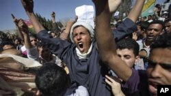 Yemeni anti-government demonstrators shout slogans during a demonstration demanding the resignation of President Ali Abdullah Saleh, in Sana'a, Yemen, February 19, 2011